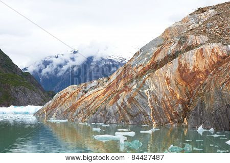 Rust Streaked Rock in Alaska Landscape
