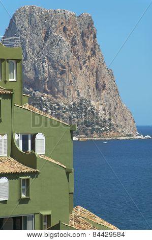 Mediterranean Coastline Landscape With Green Building In Spain. Ifach
