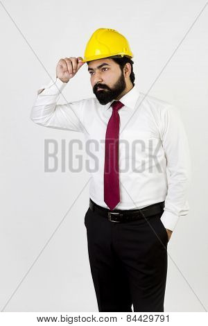Male construction worker looking at site isolated on white background