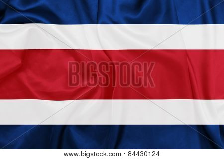 Costa Rica - Waving national flag on silk texture