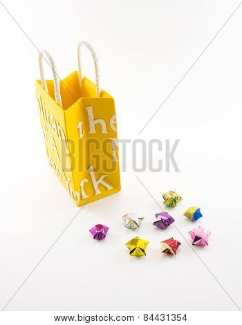 Custard Yellow Shopping Paper Bag With Hand Made Stars On White Background