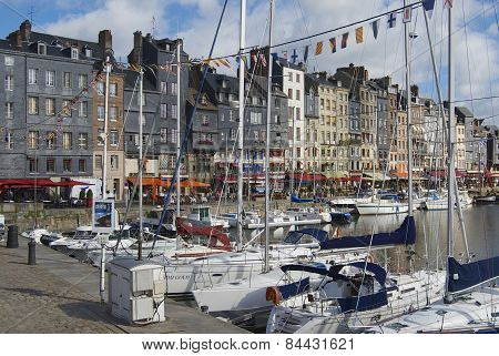 Yachts tied at the harbor in Honfleur, France.