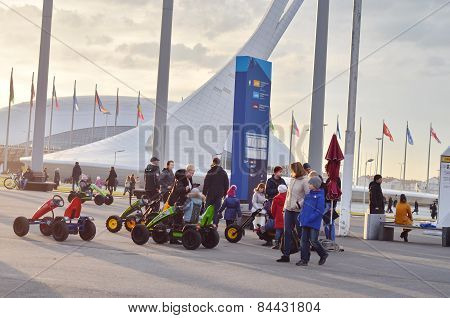 Many people in olympic park in Sochi, Russia.
