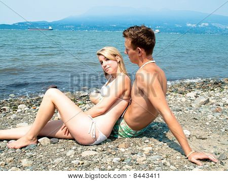 Young attractive couple at the beach