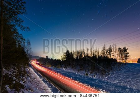 lights of cars at night from bridge at winter in austria