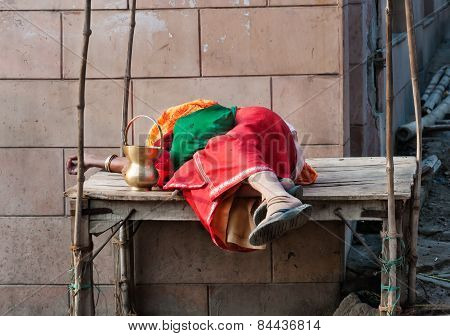 Indian Woman Sleeping On Wooden Table In The Street