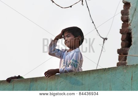 Indian Young Boy On The Roof Of The House