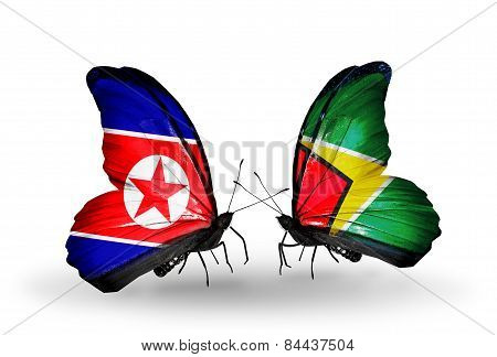 Two Butterflies With Flags On Wings As Symbol Of Relations North Korea And Guyana