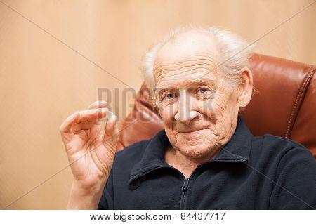 Senior Man Holding A Tablet