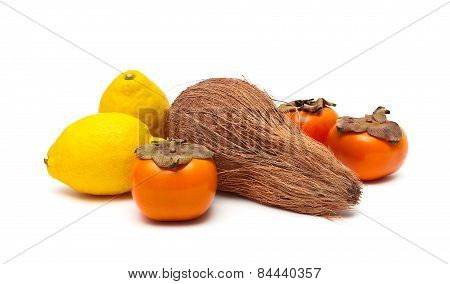 Coconut, Persimmon And Lemon Isolated On A White Background