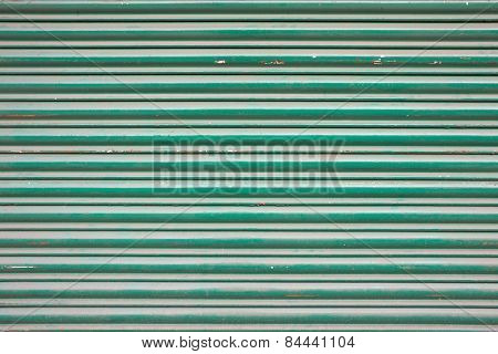 Large green metallic tin stripy fence background with scratches