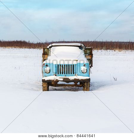 Lonely Old Rusty Truck Under The Snow