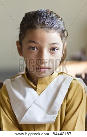 Little girl in class