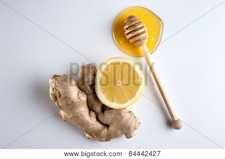 Honey And Lemon On A White Background
