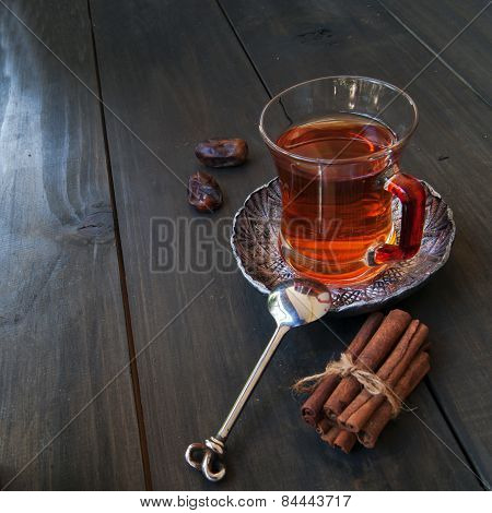 cup of tea, cinnamon, anise, teapot and flowers