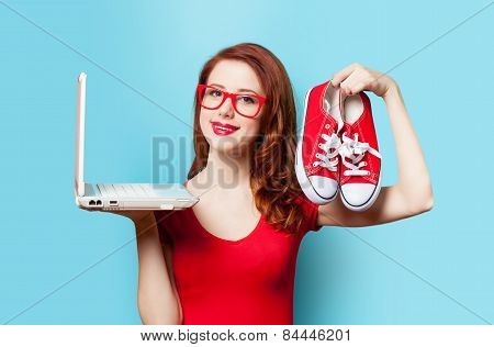 Style Redhead Girl With Gumshoes And Laptop