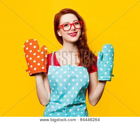 Redhead Housewife With Oven Gloves