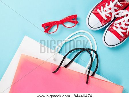 Red Gumshoes With Shpping Bags And Glasses