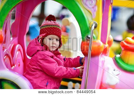 Child In Amusement Park