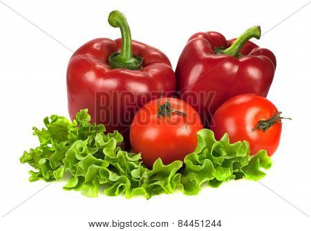 Two Red Bell Peppers With Two Tomatoes On Lettuce