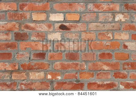 Old Brick Wall Of Red-orange Color With White Glue Residue And Dark Gray Cement Seams