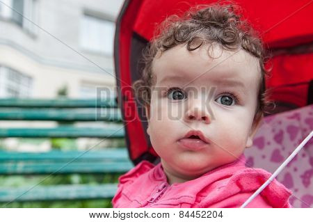 Portrait Of Baby Girl Outdoors