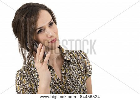Portrait of a smilling woman talking at the cell phone