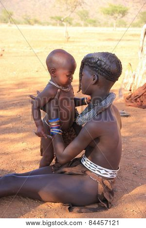 Himba Girl With A Children, Namibia