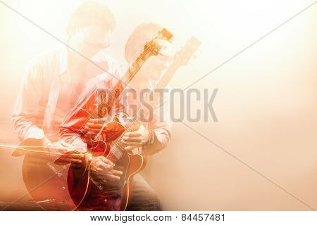 Expressive Guitarist Player With Acoustic Guitar. Shot With Combination Of Strobes And Halogen Light