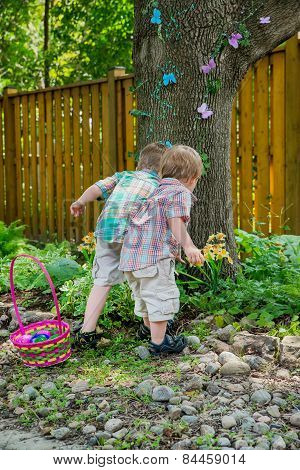 Two Boys Search For Easter Eggs
