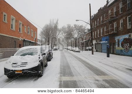 Cars under snow in Brooklyn, NY during massive Winter Storm Thor