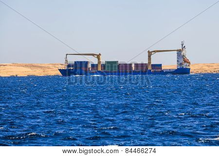 Cargo Ship With Containers. Off The Coast Of Egypt.