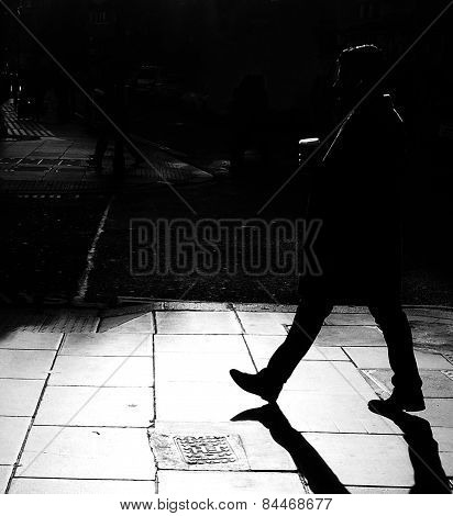 Silhouettes of a man walking