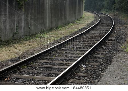 curved railway and dirty wall