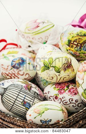Wicker Basket Full Of Various Painted Easter Eggs