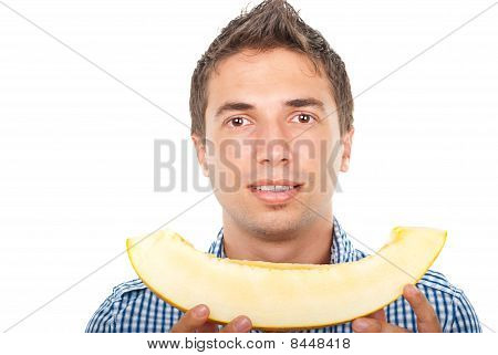 Portrait Of Young Man Holding Cantaloupe