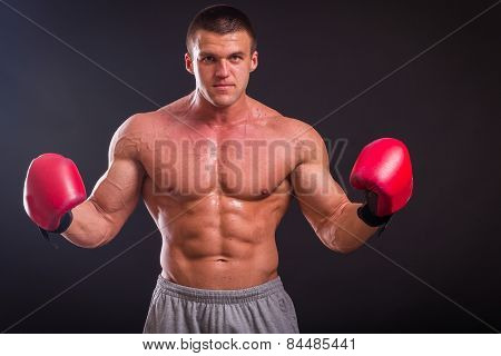 Muscular man with boxing gloves.