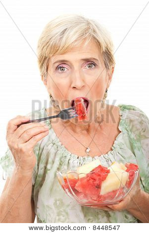 Beauty Senior Woman Eating Watermelon