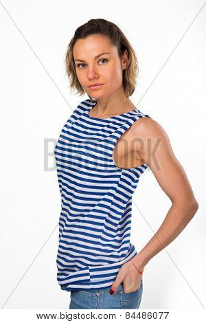 Athletic blonde in a blue striped sweater and jeans