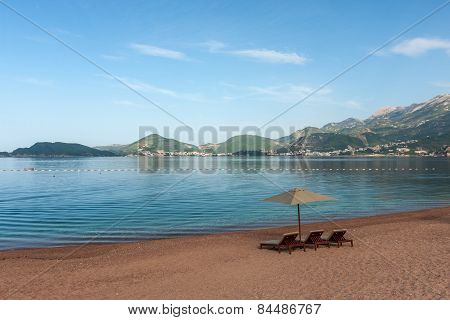 Beautiful Beach With Sunshades In Montenegro, Balkans
