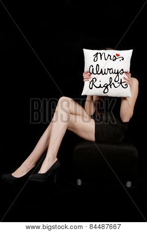 Young woman hiding her face behind a pillow Mrs. Always Right