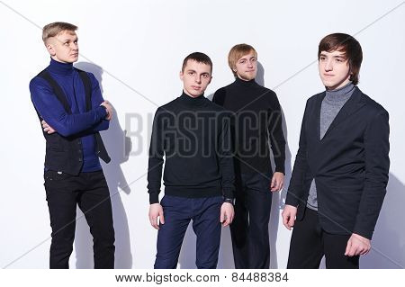 Four elegant young men