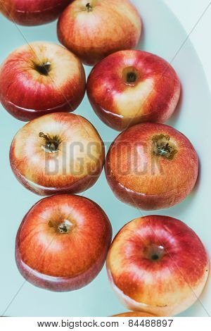Big Red Apples In Blue Water