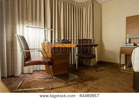 Study Room With Writing Desk And Armchairs