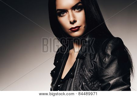 Attractive Woman With Red Lips In Black Jacket
