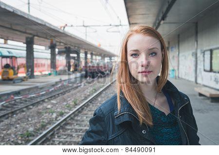 Beautiful Girl Posing In A Railroad Station