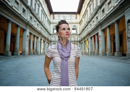 Portrait Of Young Woman Near Uffizi Gallery In Florence, Italy Looking Into Distance