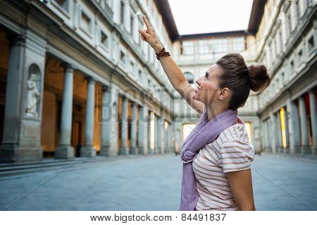 Young Woman Pointing Near Uffizi Gallery In Florence, Italy