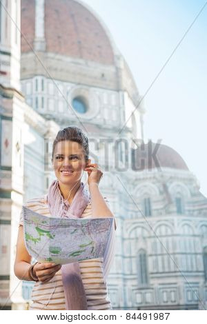 Portrait Of Happy Young Woman With Map And Audio Guide In Front