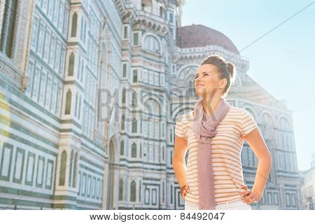 Happy Young Woman Standing In Front Of Cattedrale Di Santa Maria